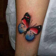 http://tattoomagz.com/red-butterfly-tattoos/blue-black-and-red-butterfly-tattoo/