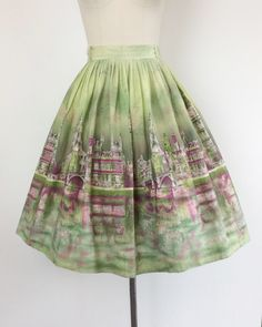 Stellar scenic London print skirt from the 50s. Love this green color way with maroon/purple buildings. Made out of medium weight cotton. Perfect for any scenic or london fan!  | c o n d i t i o n | good - a little wear to the waistband where buttons have been replaced, belt loop repairs and a small spot. nothing too noticeable.  | m e a s u r e m e n t s | fits a modern day size 8 waist - 28 inches total length - 28 inches + 2.5 inch hem (slight fade) sweep - 88 inches fabric - cotton ...
