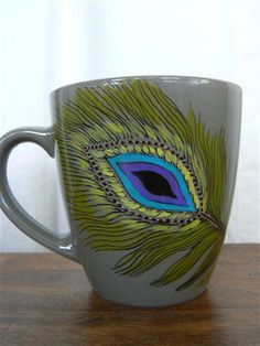 Large 16 oz Mug Hand painted with non toxic paint. Beautiful Peacock feather design with the word peace stretching off the end of the feather. A daily