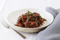 Shredded Lamb with Tomato and Basil over Rice.