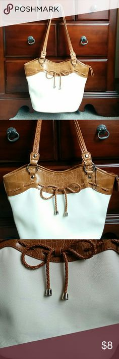 White Bow Purse Cute White and Brown Purse  Lots of inside pockets  Slight stain shown in picture 3. Bags