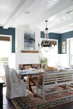 The Saturday 6 - Emily A. Clark - navy walls, white trim, rustic table, linen chairs