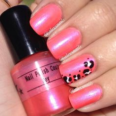 Neon peachy/pink with side 'swoosh' leopard on accent nail