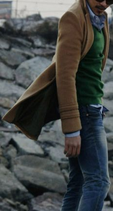 Camel jacket, green sweater and a nicely washed jeans - a great look for fall or even winter.