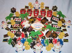 "Viva Las Vegas - Vegas themed cookies for a school dance. Poker chips and lucky 7's inspired by SweetSugarBelle from flickr, Elvis copied from cookies by cookieartisan from flickr. My son drew a picture of the slot machine(he's 11 and said he thought it should look like ""slots for kids at the local arcade???) the mini neon signs were his idea as well. For the vegas sign I found the image online and just handcut the shape and freehanded it. anyway I'm really happy with how it came out. Very…"