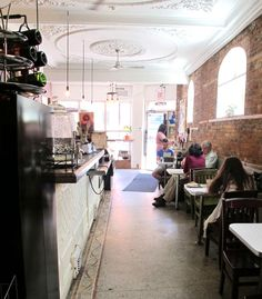 """Hamilton Ontario Canada: """"New downtown oasis put an extra shot into Hamilton's coffee culture"""" (coffee shop in previously abandoned building) Hamilton Ontario Canada, Sisters Coffee, Mulberry Street, Lots Of Windows, Coffee Culture, Residential Real Estate, Cafe Interior, Exposed Brick, Abandoned Buildings"""