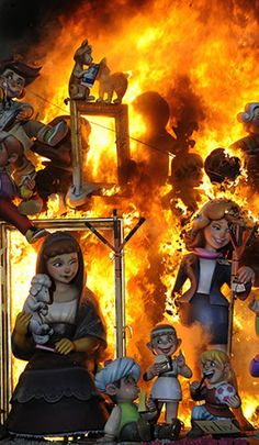 "Las Fallas festival in Valencia, Spain ~ A traditional ""ninot"" (Valencian for ""doll,"" made of wood/papier-mâché) sculpture in  a ""falla infantil"" (children's falla) burns during the last day of the festival, March 19, Feast Day of San José (St. Joseph), patron of the city 