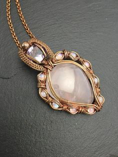 I personally adore this pendant , I feel in love with the color combination of the stones as soon as I started designing it . Entirely thought and created by me I wanted something quite large but very elegant with lots of stones but a very clean and tidy wrap . I also wanted to balance the heady and young with something very soft and romantic. Mission accomplished :).  I used solid copper wires different gauges to build the perfect setting and secure all 10 stones without being overwhelming…