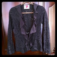 Free People Lace & Ruffle Blazer Free People Black Lace & Ruffle Blazer, size 2 fits like  0 or 00. Beautiful see through lace details and cotton ruffle collar. Sweet yet sexy. No signs on wear, in great condition. The jacket isn't faded at all, the lighting and camera couldn't pick up the colors :( make me an offer! Free People Jackets & Coats Blazers