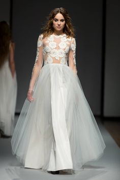French lace, vintage inspired wedding gown for the modern bohemian bride - Irene - featured at Riga Fashion Week