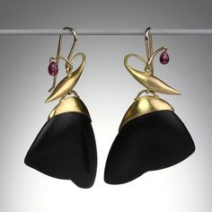 """We love these Gabriella Kiss earrings which were inspired by moths! They  feature carved black jade """"Moth Wings"""" set in 18k yellow gold caps and accented with  bright red rubies.<br><br>Measure approximately 2"""" long."""