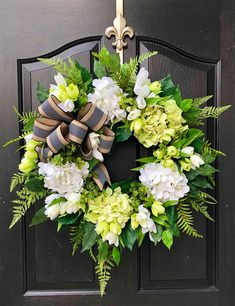 NEW ITEM! Gorgeous Elegant Year Round Door Wreath! Perfect for greeting your guests to your home with this one of a kind door wreath. Made up on an 18 grapevine wreath with moss, mixed flowing greenery of boxwood, hydrangeas leaves, ficus and gorgeous lime green ferns. Beautiful white