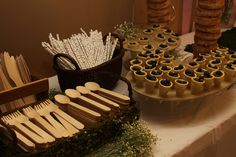 Enchanted Forest first birthday party: woodland fairy food table set up.
