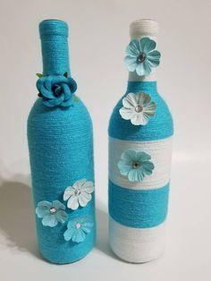 Wine bottles home decor, decorated wine bottles, wine bottles centerpiece, wine bottle vase Yarn Bottles, Wine Bottle Vases, Wine Bottle Centerpieces, Vodka Bottle, Beer Bottle Crafts, Diy Bottle, Bottle Painting, Jar Crafts, Creations