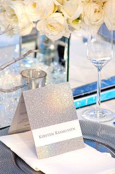 Place card to greet guests. The sparkly silver picks up the light of the candle beautifully