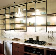 kitchen cabinets / design / sliding doors // not sure this is a great design for earthquake country but it looks cool Best Kitchen Cabinets, Upper Cabinets, Kitchen Cabinet Doors, New Kitchen, Kitchen Dining, Kitchen Decor, Glass Cabinets, Kitchen Shelves, Kitchen Storage