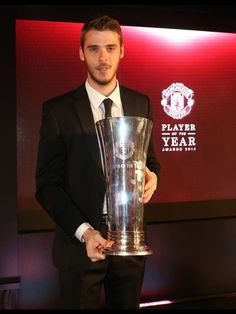 """David de Gea with the Manchester United Players' Player of the Year trophy. """"I'm really happy  grateful to win this honour."""""""