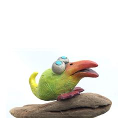This is Edwina-a ceramic Bird on driftwood branches.Bird by LooneyCreationsShop