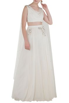Pernia Qureshi Featuring an ivory cowl neck blouse in chiffon base with floral embroidery and cross strap floor length back drape in net base. It is paired with a matching lehenga skirt. Indian Fashion Designers, Indian Designer Outfits, Designer Dresses, Lehenga Skirt, Lengha Choli, Long Blouse, Drape Blouse, Indian Dresses, Indian Outfits
