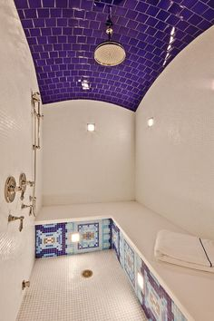 This is a WOW! of a shower with the purple tile curved ceiling and the beautiful mosaics on the bench - by David Johnston Architects.