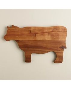 Crafted of acacia wood our adorable Cow Cutting Board provides a durable cutting surface with the rustic appeal of natural wood grain.