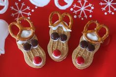 Nutter Butter cookie reindeer - need Nutter Butter cookies, M, frosting, pretzels - attach M and pretzels to cookies ad shown with a dab of frosting