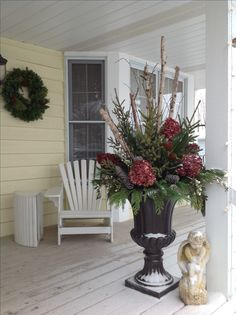 Christmas Entry urns, on Front porch using birch branches, spruce tips, cedar, pine, ice glittered twigs, magnolia leaves, glittered pine cones, dried spray painted hydrangeas, faux berry sprays, winter decor