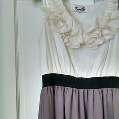 Petal Ruffle Dress Petal ruffle top dress in beautiful cream and dusty purple. Black elastic waistband hugs at natural waist. Perfect spring style! Dresses