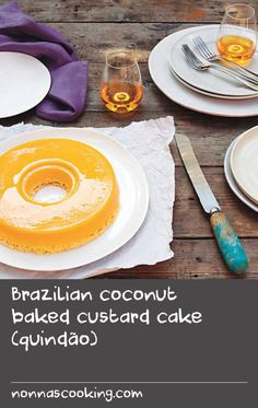 Brazilian coconut baked custard cake (quindão) | This rich bright yellow dessert has a sweet silky egg custard with a slightly chewy coconut base. Its high egg content of 18 egg yolks reflects Brazil's Portuguese influence and, with the addition of coconut, its African one too. It is a perfect dessert for entertaining as it can be prepared a day in advance.