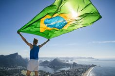 athlete stands holding a brazilian flag at a bright overlook of the city skyline of rio de janeiro brazil Visit Brazil, Brazil Brazil, Cross Cultural Communication, Living In Brazil, Business Visa, Las Vegas Homes, South America, Tourism, Photo Editing