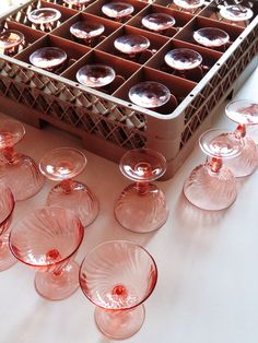 Vintage pink swirl champagne coupes from the rental collection.