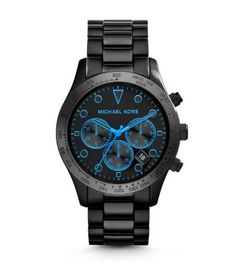 Generous in size and style, our Layton watch offers up a study in contrasts. The tough, matte-black exterior is balanced with bright blue accents for a bold finish. We especially love it with head-to-toe black. -- Michael Kors