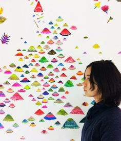 I love the sea of little cut-out paintings displayed on a wall, from the art room plant: Tomoyo Kawase