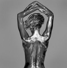 Back in 1995, photographer Guido Argentini was inspired to photograph a model coated in silver body paint . Nearly twenty years and countless shoots later, Argentini has prepared a collection of this work in a new book titled ARGENTUM.