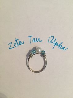 A personal favorite from my Etsy shop https://www.etsy.com/listing/470616369/zeta-tau-alpha-wrapped-wire-beaded-pearl