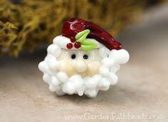 Hey, I found this really awesome Etsy listing at https://www.etsy.com/listing/165015982/lampwork-santa-bead-ho-ho-ho