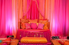 Draping fabrics + load of color + gaddas & throw pillows = mehendi musts. But Id like this better with different colors