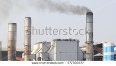 Pollution, smoke and steam discharged from an industrial facility