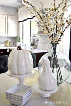 White pumpkins and and a vase from HomeGoods with pretty flowers make an ideal centerpiece for a sophisticated and elegant table  (sponsored pin)