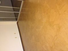 Contractors paper torn, glued down with white glue, then 4 coats of verathane.  Dining room floor re-do for under $100!