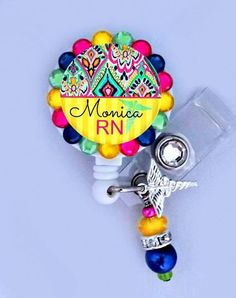 Yellow and blue Nurse ID badge reel by Badgetopia on Etsy, $11.00