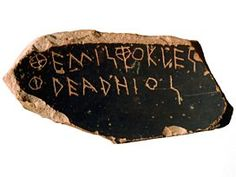 A close up of an ostracon showing the name Themistocles