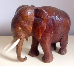 Vintage Wooden Elephant. A large beautifully carved piece with