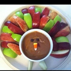 Caramel Apple Dip (buy it already made in the produce section of your grocery store). Add sliced apples, a candy corn for the beak, chocolate chips for the eyes and this turkey's ready for  Thanksgiving munching!