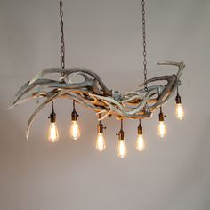 Mountain Modern Antler Chandeliers... Would be super pretty woth greenery folded in and longer dangling lights