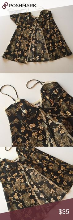 """Vintage Victoria's Secret Satin Chemise Excellent condition. Never worn. Black with gold floral print. Lace border. Open front with a lace tie at the top. Thong bottom. Adjustable straps. 16"""" from armpit to armpit. Approximately 30"""" long. 100% polyester. Not from a smoke-free house. Victoria's Secret Intimates & Sleepwear Chemises & Slips"""