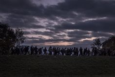 Oct. 23, 2015. Migrants walking along a dike, escorted by Slovenian riot police, to a registration camp outside Dobova.