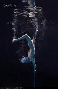 Underwater Pole Dancing by Brett Stanley | Buy a royalty-free license of this photo from 500px Prime's collection of premium photos.