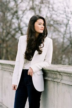 Simple and elegant look on Peony Lim - a crisp white jacket, a beautiful blouse with lace detailing and a pair of gently flared jeans - it is difficult to go wrong.