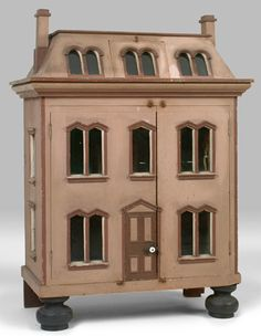 Victorian Dolls' House- Circa 1860  - totally original condition. The dolls' house was copied after a house in Rhode Island and retains its soft beige facade with darker trim. c.1860